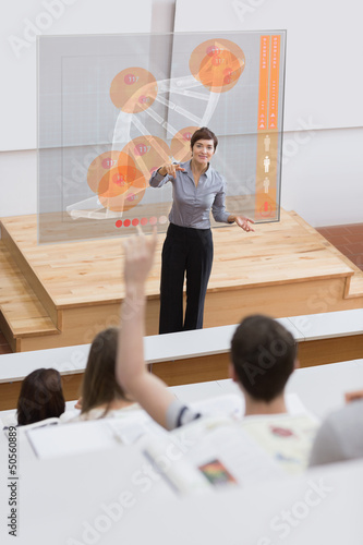 Teacher in front of futuristic interface university college stud
