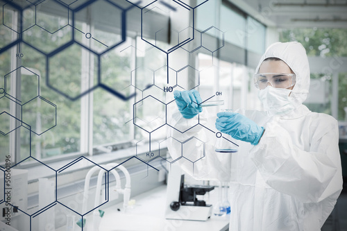 Chemist in protective suit working with futuristic interface wit