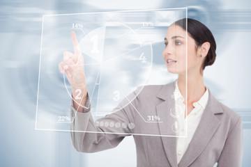 Businesswoman using nice transparent futuristic interface