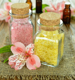 Sea salt in glass bottles and flower