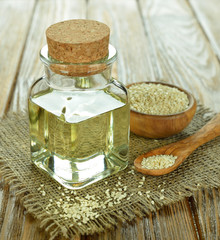 sesame oil in a glass bottle on a brown table