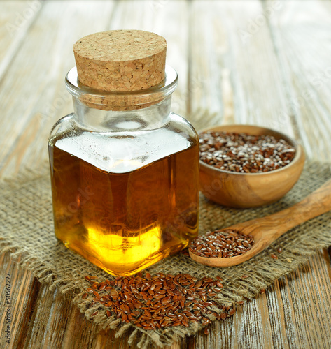 Linseed oil in a glass bottle on a brown table