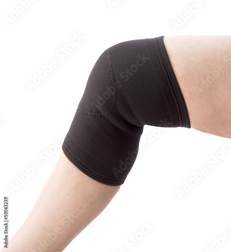 female senior with knee support on a white background