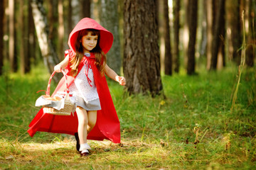 "girl runs on the wood. the fairy tale "" Red Riding Hood"""