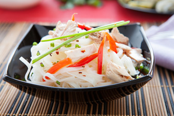 Chinese rice noodles and slices of tuna