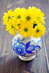 yellow flowers in a vase.