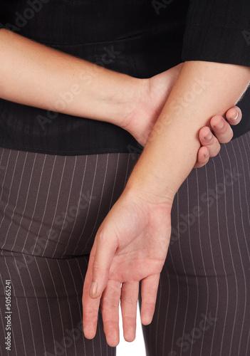Arms behind back