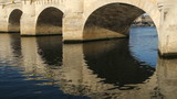 Detail of three Pont Neuf arches in morning sun in Paris, France
