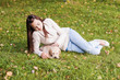 Girl with her dog resting outdoors