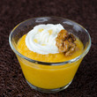 pudding with pumpkin and mango in a glass beaker