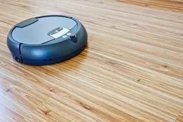 modern floor cleaning robot on laminate floor