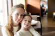 Mother and daughter together in restaurant