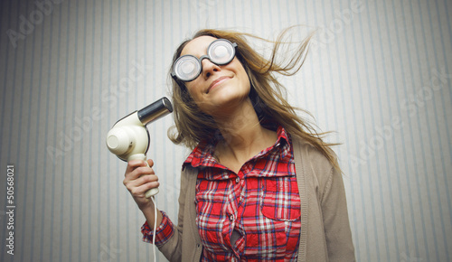 Nerdy woman drying hair
