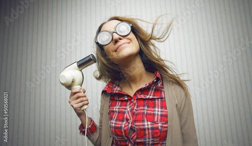Nerdy woman drying hair