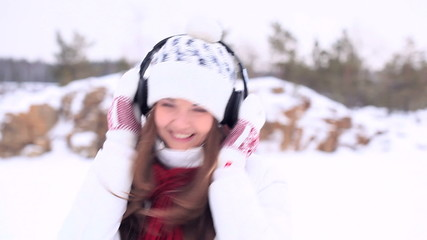 Winter Girl. Dancing with headphones.