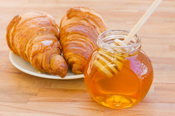 breafast with croissants and honey