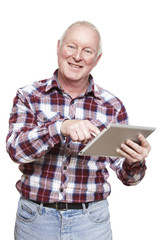Senior man using tablet computer smiling