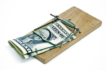 one dollar bill in a mousetrap