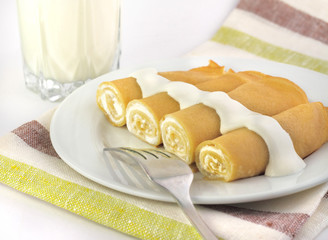 Sweet crepes stuffed with cottage cheese
