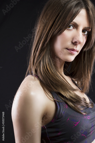 sport young woman face of fitness girl studio shot over black ba