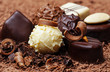 a chocolate background with pralines - 50574288