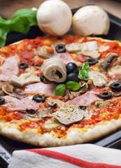 Pizza capricciosa ham olives and artichokes