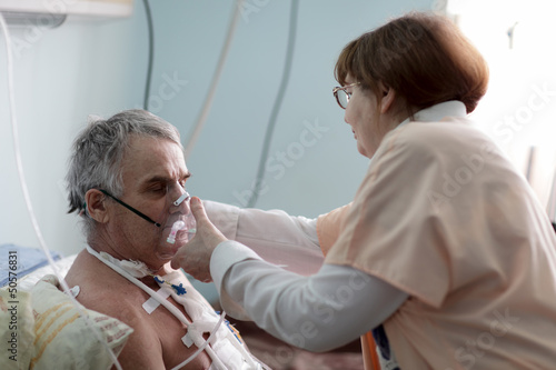 Nurse fixing oxygen mask