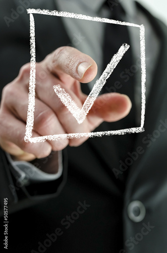 Business man making a checkmark