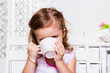 Preschool girl with a cup