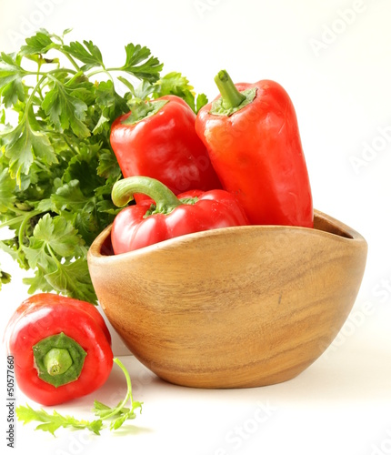 Fresh ripe red bell paprika peppers and parsley