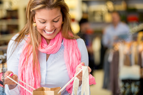 Woman looking into a shopping bag