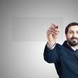 business man writing on imaginary screen