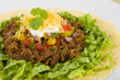 Mexican shredded beef in soft corn tortilla and toppings.