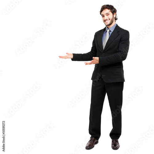 Full length businessman showing empty space