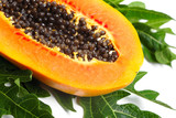 Ripe papaya with seeds and green leaf isolated on a white backgr
