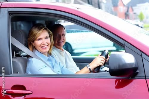 Happy senior couple in the car.