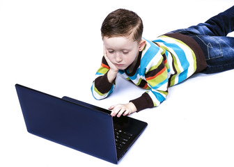 boy looking at laptop monitor