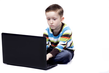 boy playing with a laptop