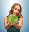 woman holding green globe on her hands