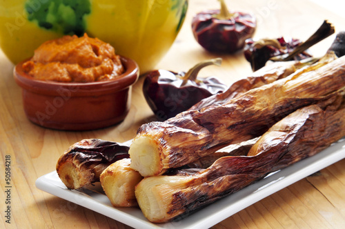 barbecued calcots, catalan sweet onions, and romesco sauce
