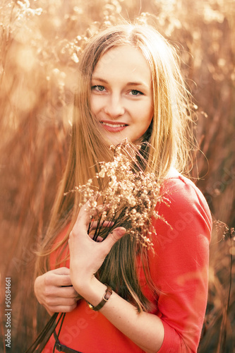beautiful young woman outdoors in the spring with buquet