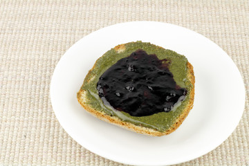 Hemp Butter and Blueberry Preserves on Bread