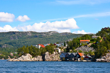 Houses and huts on the shore of  Bergen fjord.