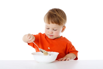 Little boy eating the oatmeal