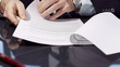 Close up of businessman signing a contract
