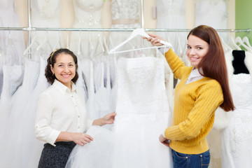 women chooses white gown