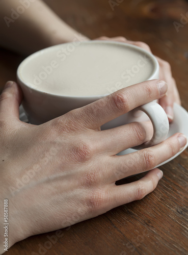 Woman Holding Her Morning Cup of Coffee