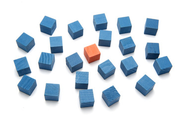 Concept photo think different one orange block and blue blocks