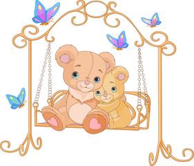 Pair of bears on a swing