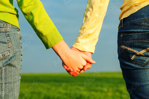 Teen girls holding hands